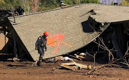 (Mike Eliason/Santa Barbara County Fire Department via AP). This photo provided by the Santa Barbara County Fire Department shows firefighters making secondary searches on homes damaged and destroyed by deadly rain and mudflow in Montecito, Calif., Fri...