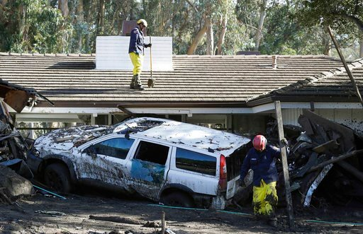 (AP Photo/Marcio Jose Sanchez). Emergency crew members search an area damaged by storms in Montecito, Calif., Friday, Jan. 12, 2018. The number of missing after a California mudslide has fluctuated wildly, due to shifting definitions, the inherent unce...