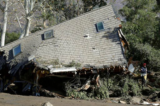 (AP Photo/Marcio Jose Sanchez). Emergency crew members search an area near houses damaged by storms in Montecito, Calif., Friday, Jan. 12, 2018. The number of missing after a California mudslide has fluctuated wildly, due to shifting definitions, the i...