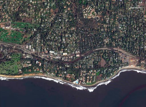 (DigitalGlobe News Bureau via AP). This Jan. 10, 2018 satellite image released by DigitalGlobe News Bureau shows Highway 101 after storms caused mudslides and flooding in Montecito, Calif. The number of missing after a California mudslide has fluctuate...
