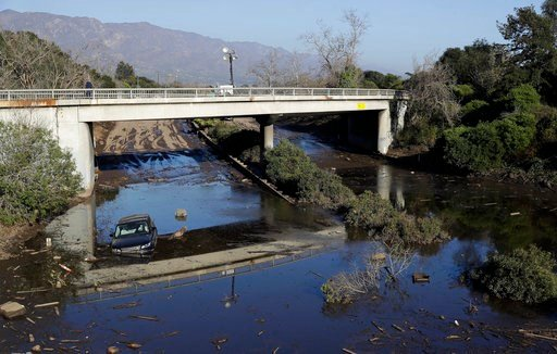 (AP Photo/Marcio Jose Sanchez). A car sits in flooded water on Highway 101 in Montecito, Calif., Thursday, Jan. 11, 2018. Rescue workers slogged through knee-deep ooze and used long poles to probe for bodies Thursday as the search dragged on for victim...