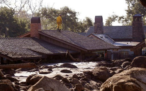 (AP Photo/Marcio Jose Sanchez). A Cal Fire search and rescue crew looks over a home damaged by storms in Montecito, Calif., Friday, Jan. 12, 2018.  The mudslide, touched off by heavy rain, took many homeowners by surprise early Tuesday, despite warning...