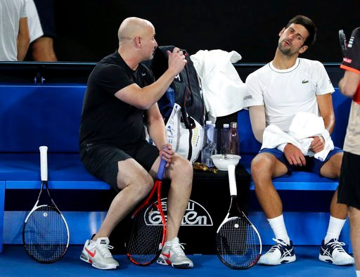 (AP Photo/Ng Han Guan). Serbia's Novak Djokovic talks with coach Andre Agassi, left, during a practice session ahead of the Australian Open tennis championships in Melbourne, Australia, Saturday, Jan. 13, 2018.