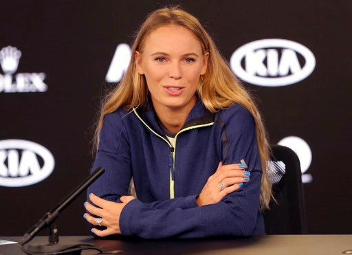(AP Photo/Dita Alangkara). Denmark's Caroline Wozniacki answers questions during a press conference at the Australian Open tennis championships in Melbourne, Australia, Saturday, Jan. 13, 2018.