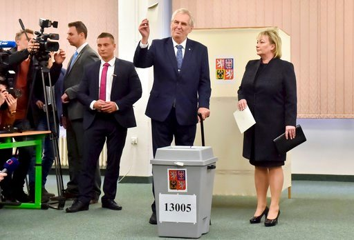 (Vit Simanek/CTK via AP). Presidential candidate and Czech President Milos Zeman shows his vote as his wife Ivana, right, looks on during the presidential election's first round vote in Prague, on Friday, Jan. 12, 2018. Czech Republic's president Milos...