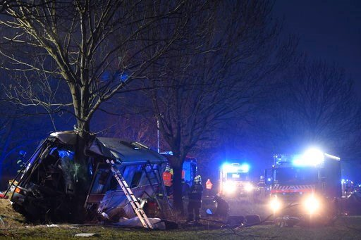 (Ondrej Deml/CTK via AP). Rescue workers and firemen work at a bus after its collision with a car at Horomerice near Prague, Czech Republic, Friday 12, 2018. The accident claimed three lives and 30 injuries. At least ten people have serious injuries.