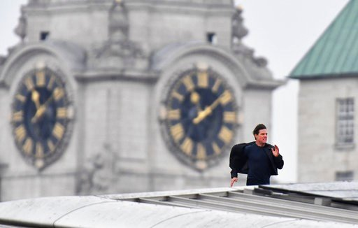 (John Stillwell/PA via AP). Actor Tom Cruise runs along the rooftop of Blackfriars station, during filming for the new Mission Impossible 6 film, in London, Saturday Jan. 13, 2018.