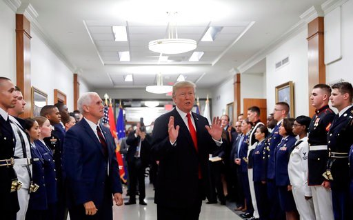 (AP Photo/Pablo Martinez Monsivais). FILE - In this July 20, 2017, file photo, President Donald Trump stops to answer a reporter's question after greeting military personnel during a visit to the Pentagon. Watching is Vice President Mike Pence. With Ru...