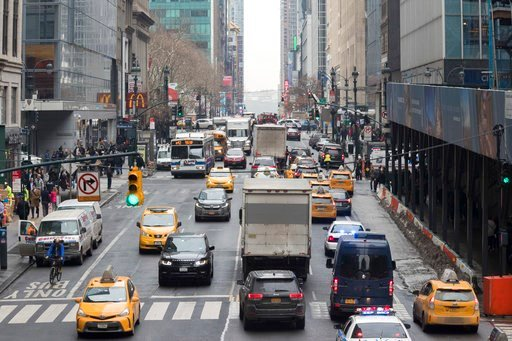 (AP Photo/Mary Altaffer). In this Thursday, Jan. 11, 2018 photo, traffic is seen making it's way across 42nd Street in New York. A proposal to make part Manhattan a toll zone, where drivers would be charged to drive into the most congested neighborhood...