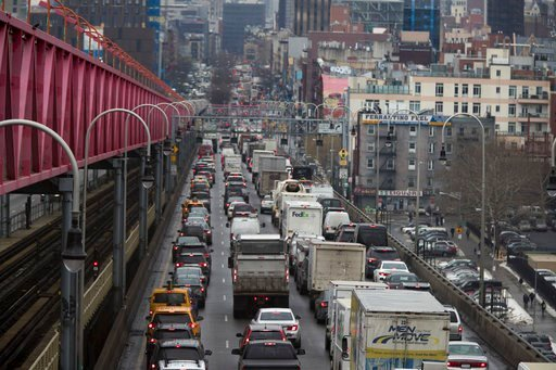 (AP Photo/Mary Altaffer). In this Thursday, Jan. 11, 2018 photo, traffic crosses the Williamsburg bridge in New York from Brooklyn into Manhattan. A proposal to make part of Manhattan a toll zone, where drivers would be charged to drive into the most c...