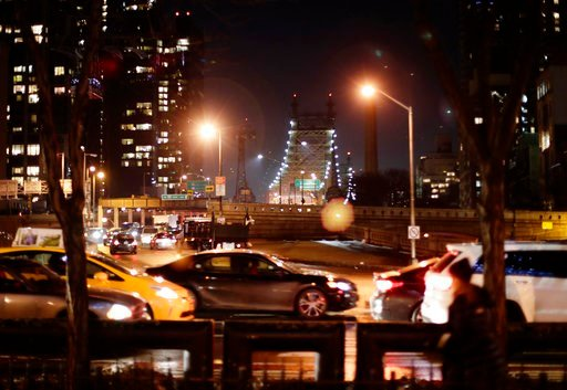 (AP Photo/Frank Franklin II). In this Jan. 11, 2018, cars and pedestrians pass the Queensboro Bridge in New York. Congestion pricing, a proposal to thin New York City's bad traffic by making part of Manhattan a toll zone is gaining momentum after years...