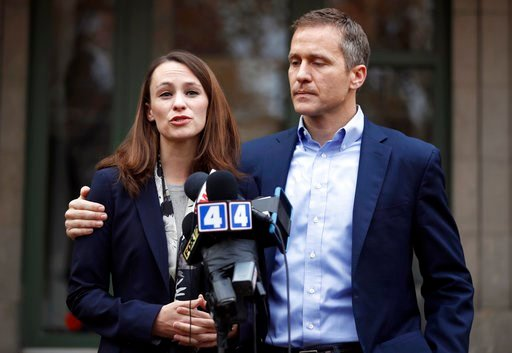 (AP Photo/Jeff Roberson, File). FILE - In this Dec. 6, 2016, file photo, Missouri Gov.-elect Eric Greitens and his wife Sheena speak to the media in St. Louis after she had been robbed at gunpoint the day before. Missouri Gov. Eric Greitens appears to ...