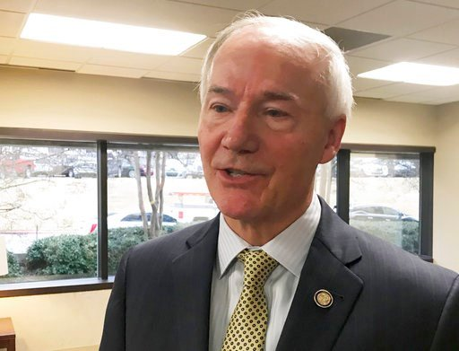 (AP Photo/Andrew DeMillo, File). =FILE - In this Jan. 9, 2018, file photo, Arkansas Gov. Asa Hutchinson speaks to reporters in Little Rock, Ark., about his proposed budget for the coming fiscal year. The Republican governor has proposed adding a work r...