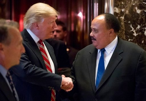 (AP Photo/Andrew Harnik, File). FILE- In this Jan. 16, 2017 file photo, President-elect Donald Trump shakes hands with Martin Luther King III, son of Martin Luther King Jr. at Trump Tower in New York. King III, met with Trump on the last King holiday, ...
