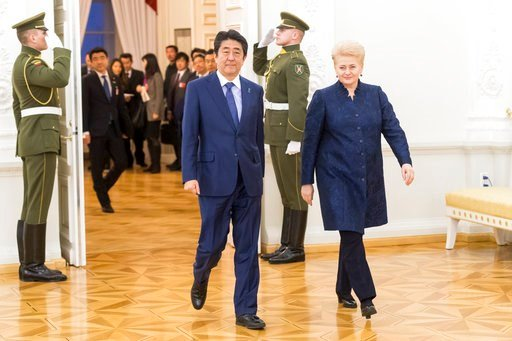 (AP Photo/Liusjenas Kulbis). Lithuania's President Dalia Grybauskaite, right, and Japanese Prime Minister Shinzo Abe walk together for their meeting at the President's palace in Vilnius, Lithuania, Saturday, Jan. 13, 2018.