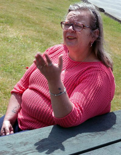 (Geoff Forester/Concord Monitor via AP). In this June 2, 2016 photo, Heidi Lilley speaks about her arrest the previous  week, for going topless at Weirs Beach in Laconia, N.H. The state Supreme Court is expected to hear a case as early as January 2018 ...