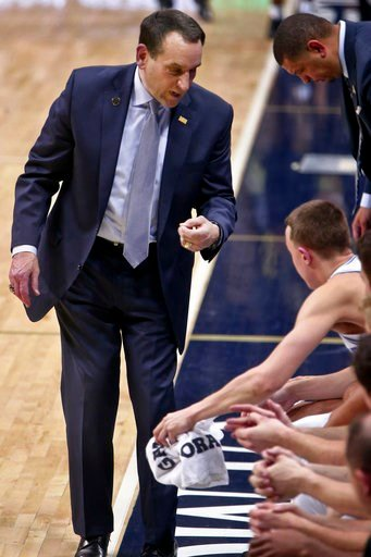 (AP Photo/Keith Srakocic). Duke coach Mike Krzyzewski, left, talks to Alex O'Connell, seated top, and others on the bench during the second half of an NCAA college basketball game against Pittsburgh, Wednesday, Jan. 10, 2018, in Pittsburgh. Duke won 87...