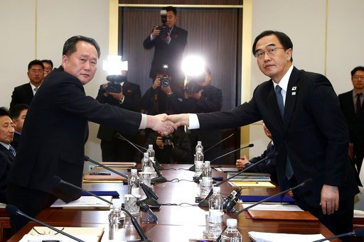 (Korea Pool via AP). FILE - In this Tuesday, Jan. 9, 2018, file photo, South Korean Unification Minister Cho Myoung-gyon, right, shakes hands with the head of North Korean delegation Ri Son Gwon during their meeting at the Panmunjom in the Demilitarize...