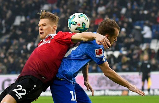 (Peter Steffen/dpa via AP). Hannover's Matthias Ostrzolek, left, and Mainz' Daniel Brosinski challenge for the ball during the German Bundesliga soccer match between Hannover 96 and FSV Mainz 05, in Hannover, Germany. Saturday, Jan. 13, 2018.