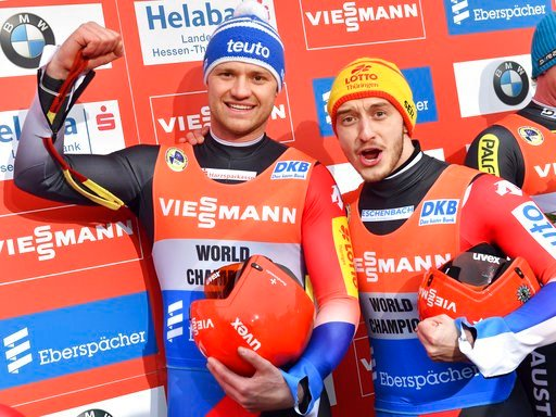 (Martin Schutt/dpa via AP). Germany's Toni Eggert, left, and Sascha Benecken  celebrate their victory after the men's doubles race at the Luge World Cup in Oberhof, Germany, Saturday, Jan. 13, 2018.