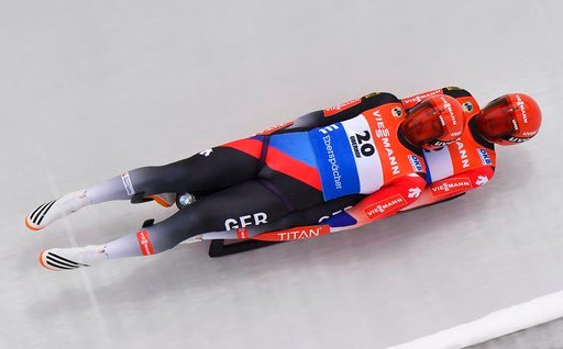 (Martin Schutt/dpa via AP). Germany's Tobias Wendl and  Tobias Arlt  compete during the men's doubles race at the Luge World Cup in Oberhof, Germany, Saturday, Jan. 13, 2018.