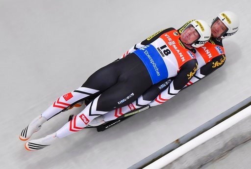 (Martin Schutt/dpa via AP). Austria's Peter Penz  and  Georg Fischler compete during the men's doubles race at the Luge World Cup in Oberhof, Germany, Saturday, Jan. 13, 2018.