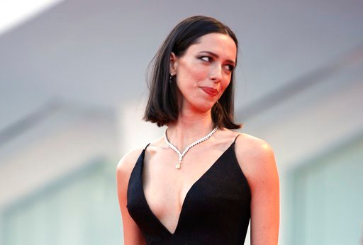 (AP Photo/Domenico Stinellis, File). FILE - In this Sept. 5, 2017 file photo, actress Rebecca Hall poses for photographers at the premiere of the film 'mother!' at the 74th edition of the Venice Film Festival in Venice, Italy,  Hall says she's donating...