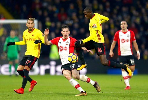 (Steven Paston/PA via AP). Watford's Abdoulaye Doucoure, right, battles for the ball with Southampton's Pierre-Emile Hojbjerg during the English Premier League soccer match at Vicarage Road, Watford, England, Saturday Jan. 13, 2018.