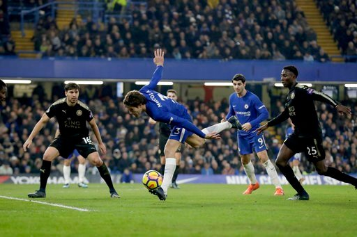 (AP Photo/Matt Dunham). Chelsea's Marcos Alonso controls the ball with Leicester City's during the English Premier League soccer match between Chelsea and Leicester City at Stamford Bridge stadium in London, Saturday, Jan. 13, 2018.