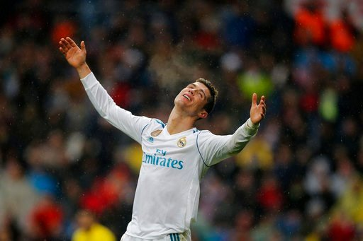 (AP Photo/Paul White). Real Madrid's Cristiano Ronaldo reacts during a Spanish La Liga soccer match between Real Madrid and Villarreal at the Santiago Bernabeu stadium in Madrid, Spain, Saturday, Jan. 13, 2018.