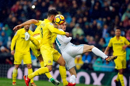 (AP Photo/Paul White). Real Madrid's Gareth Bale, centre and Villarreal's Alvaro Gonzalez go for a header in the goalmouth during a Spanish La Liga soccer match between Real Madrid and Villarreal at the Santiago Bernabeu stadium in Madrid, Spain, Satur...