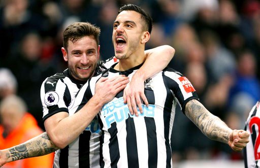 (Owen Humphreys/PA via AP). Newcastle United's Joselu, right, celebrates scoring his side's first goal of the game with team mate Paul Dummett during the English Premier League soccer match against Swansea City at St James' Park, Newcastle, England, Sa...