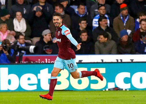 (Martin Rickett/PA via AP). West Ham United's Manuel Lanzini celebrates scoring his side's fourth goal of the game against Huddersfield Town during the English Premier League soccer match against West Ham United at the John Smith's Stadium, Huddersfiel...