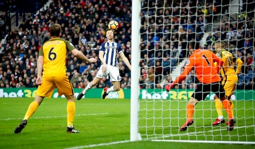 (Nick Potts/PA via AP). West Bromwich Albion's Jonny Evans scores his side's first goal of the game against Brighton & Hove Albion during the English Premier League soccer match at The Hawthorns, West Bromwich, England, Saturday Jan. 13, 2018.