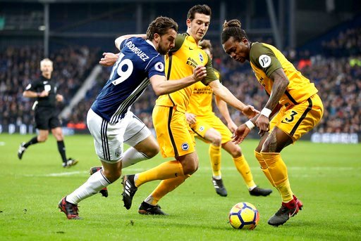 (Nick Potts/PA via AP). West Bromwich Albion's Jay Rodriguez, left, battles for the ball with Brighton & Hove Albion's Lewis Dunk and Gaetan Bong, right, during the English Premier League soccer match against Brighton at The Hawthorns, West Bromwic...