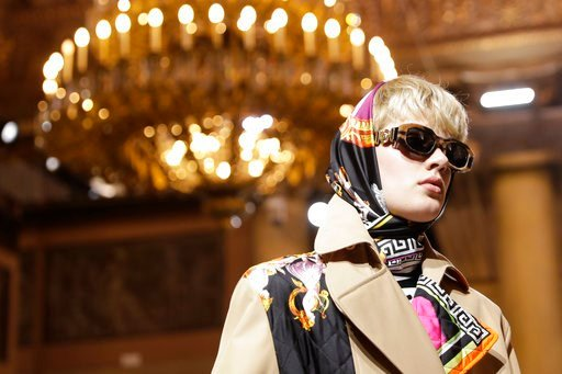 (AP Photo/Luca Bruno). A model wears a creation as part of Versace men's Fall-Winter 2018-19 collection, that was presented in Milan, Italy, Saturday, Jan.13, 2018.