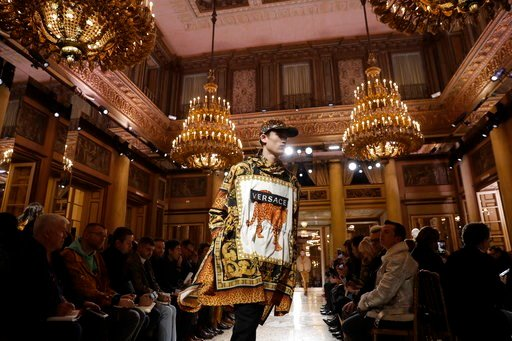 (AP Photo/Luca Bruno). A model wears a creations as part of Versace men's Fall-Winter 2018-19 collection, that was presented in Milan, Italy, Saturday, Jan.13, 2018.