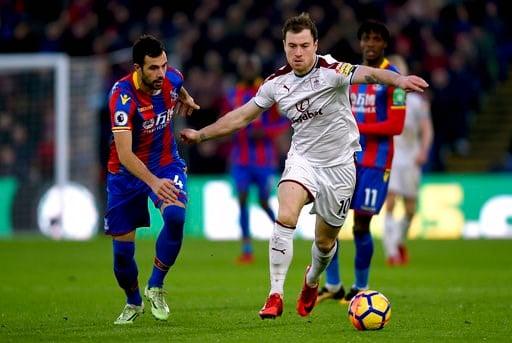 (Daniel Hambury/PA via AP). Crystal Palace's Luka Milivojevic, left, and Burnley's Ashley Barnes battle for the ball during the English Premier League soccer match at Selhurst Park, London, Saturday Jan. 13, 2018.