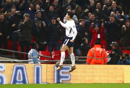 (John Walton/PA via AP). Tottenham Hotspur's Son Heung-Min celebrates scoring his side's first goal of the game during the English Premier League soccer match at Wembley Stadium, London, Saturday Jan. 13, 2018.