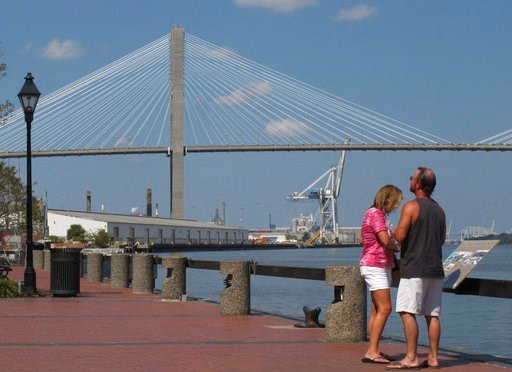 (AP Photo/Russ Bynum). FILE - This Sept. 28, 2017 file photo shows the Eugene Talmadge Memorial Bridge over the Savannah river, in Savannah, Ga.  The Girl Scouts have hired a lobbyist, met with the governor and made plans for a milk-and-cookies recepti...