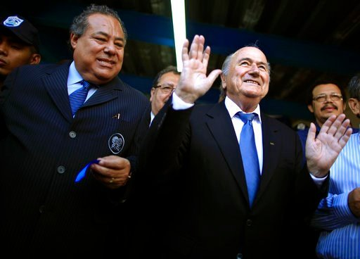 (AP Photo/Esteban Felix, File). FILE - This April 14, 2011 file photo shows Nicaragua Soccer Federation President Julio Rocha, left, and FIFA President Joseph S. Blatter, at the end of a ceremonial ribbon cutting for the National Soccer Stadium in Mana...