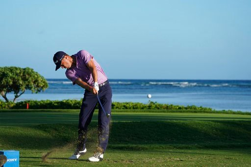 (AP Photo/Marco Garcia). Justin Thomas drives from the 17th tee during the first round of the Sony Open golf tournament Thursday, Jan. 11, 2018, in Honolulu.