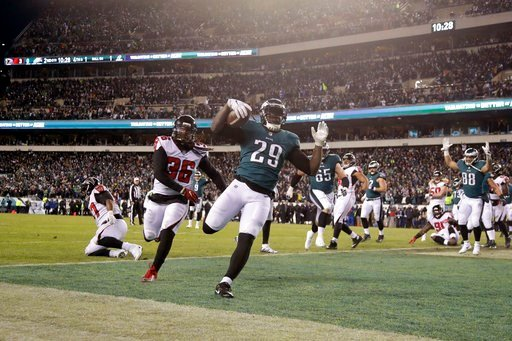 (AP Photo/Michael Perez). Philadelphia Eagles' LeGarrette Blount scores a touchdown during the first half of an NFL divisional playoff football game against the Atlanta Falcons, Saturday, Jan. 13, 2018, in Philadelphia.
