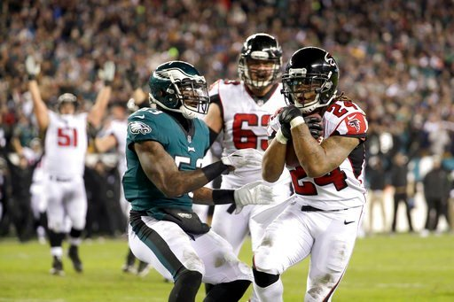 (AP Photo/Chris Szagola). Atlanta Falcons' Devonta Freeman (24) scores a touchdown against Philadelphia Eagles' Nigel Bradham (53) during the first half of an NFL divisional playoff football game, Saturday, Jan. 13, 2018, in Philadelphia.