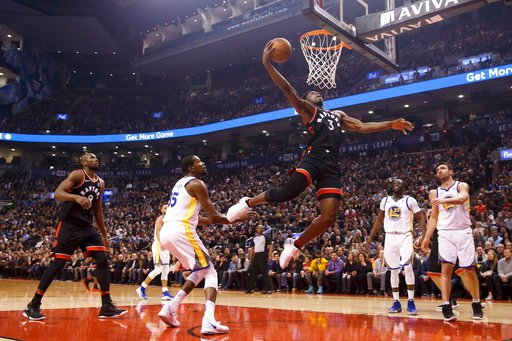 (Cole Burston/The Canadian Press via AP). Toronto Raptors forward OG Anunoby (3) goes up for a dunk against the Golden State Warriors during the first half of an NBA basketball game Saturday, Jan. 13, 2018, in Toronto.