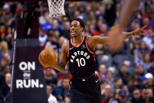 (Cole Burston/The Canadian Press via AP). Toronto Raptors' DeMar DeRozan (10) takes the ball up the court during the first half of the team's NBA basketball game against the Golden State Warriors on Saturday, Jan. 13, 2018, in Toronto.
