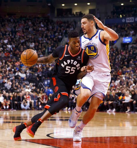 (Cole Burston/The Canadian Press via AP). Toronto Raptors guard Delon Wright (55) drives against Golden State Warriors guard Klay Thompson (11) during the first half of an NBA basketball game Saturday, Jan. 13, 2018, in Toronto.