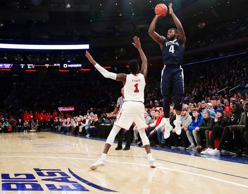 (AP Photo/Frank Franklin II). Villanova's Eric Paschall (4) shoots over St. John's Bashir Ahmed (1) during the first half of an NCAA college basketball game Saturday, Jan. 13, 2018, in New York.
