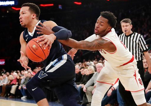 (AP Photo/Frank Franklin II). Villanova's Jalen Brunson, left, drives past St. John's Shamorie Ponds during the first half of an NCAA college basketball game Saturday, Jan. 13, 2018, in New York.