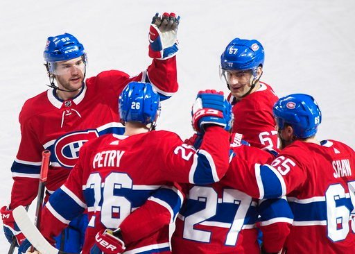 (Graham Hughes/The Canadian Press via AP). Montreal Canadiens' Alex Galchenyuk (27) celebrates with teammates Jonathan Drouin (92) Max Pacioretty, (67), Jeff Petry (26) and Andrew Shaw (65) after scoring against the Boston Bruins during second period N...